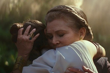 Carrie Fisher as General Leia Organa and Daisy Ridley as Rey in